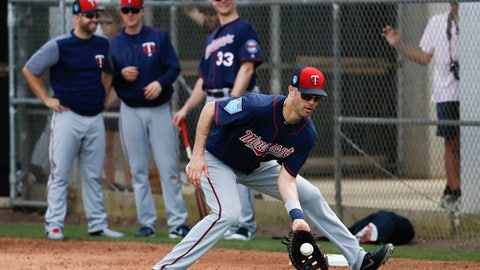 Minnesota Twins first baseman Joe Mauer practices a drill during spring training baseball, Wednesday, Feb. 21, 2018, in Fort Myers, Fla. (AP Photo/John Minchillo)
