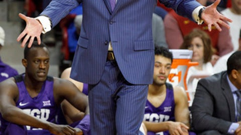 TCU head coach Jamie Dixon talks to his team during the first half of an NCAA college basketball game against Iowa State, Wednesday, Feb. 21, 2018, in Ames, Iowa. (AP Photo/Scott Morgan)
