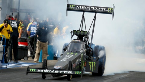 "FILE - In this Oct. 15, 2017, file photo provided by the NHRA, Brittany Force races to the Top Fuel victory at the AAA Texas NHRA FallNationals drag races at Texas Motorplex in Ennis, Texas.  Force remembers nothing about the hard crash that hospitalized her overnight during the NHRA season opener nearly two weeks ago. The defending Top Fuel champion says in a question-and-answer session released by her team, John Force Racing, that she watched part of the crash on a cell phone and ""it was much worse than I expected."" Force was hospitalized following a wall-banging accident at the Winternationals in Pomona, Calif,, on Feb. 11. (Jerry Foss/NHRA via AP, File)"