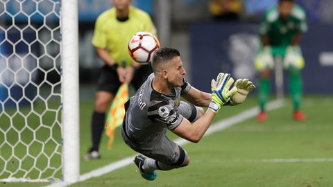 Goalkeeper Marcelo Grohe of Brazil's Gremio makes a save during the penalty shootout at the Recopa Sudamericana final soccer match against Argentina's Independiente in Porto Alegre, Brazil, Thursday, Feb. 22, 2018. Gremio won in a penalty shootout after an aggregate 1-1 draw. (AP Photo/Andre Penner)