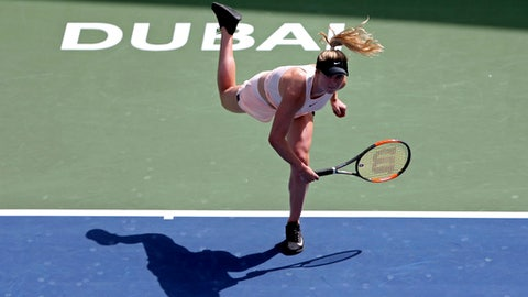 Elina Svitolina of Ukraine rserves the ball to Naomi Osaka of Japan during a quarter final match of the Dubai Duty Free Tennis Championship in Dubai, United Arab Emirates, Thursday, Feb. 22, 2018. (AP Photo/Kamran Jebreili)