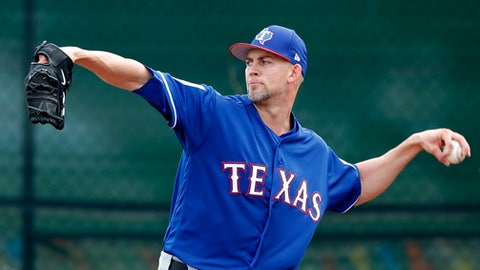 FILE - In this Feb. 15, 2018, file photo, Texas Rangers pitcher Mike Minor throws during a baseball spring training workout,in Surprise, Ariz. Minor thought he might never pitch again while missing two full seasons with shoulder issues. The former first-round draft pick now gets a chance to start again after being a full-time reliever in his return last year. (AP Photo/Charlie Neibergall, File)