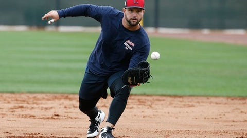 FILE - In this Feb. 16, 2018, file photo, Cleveland Indians first baseman Yonder Alonso gets ready to field a grounder at the Indians spring training facility, in Goodyear, Ariz. Unable to produce big power numbers, Alonso altered his swing last season and the baseball began to fly. After hitting just 39 home runs in his first seven major league seasons, Alonso connected for 28 last year in 142 games for Oakland and Seattle. The Indians are counting on his power surge to continue. (AP Photo/Ross D. Franklin, File)
