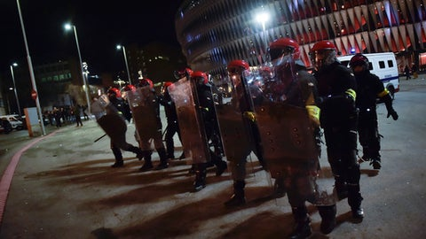 Basque riot policemen control the perimeter of the stadium close to FC Spartak Moskva's followers before the match during the Europa League - round of 32, 2nd leg, between Athletic Bilbao and FC Spartak Moskva, at San Mames stadium, in Bilbao, northern Spain, Thursday, Feb.22, 2018. (AP Photo/Alvaro Barrientos)