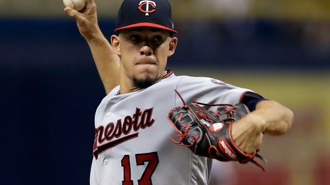 FILE - In this Monday, Sept. 4, 2017 file photo, Minnesota Twins' Jose Berrios pitches to the Tampa Bay Rays during the first inning of a baseball game in St. Petersburg, Fla. Jose Berrios made major strides for the Minnesota Twins last season after a rough rookie year. Now comes the next step, establishing himself as a truce ace of the rotation. (AP Photo/Chris O'Meara, File)