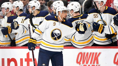 Buffalo Sabres left wing Evander Kane (9) is congratulated after scoring a power-play goal against the Detroit Red Wings diring the second period of an NHL hockey game Thursday, Feb. 22, 2018, in Detroit. (AP Photo/Jose Juarez)