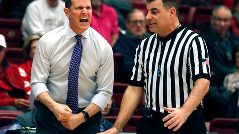 Washington head coach Mike Hopkins agues with referee during the first half against Washington in an NCAA college basketball game Thursday, Feb. 22, 2018, in Stanford, Calif. (AP Photo/Tony Avelar)