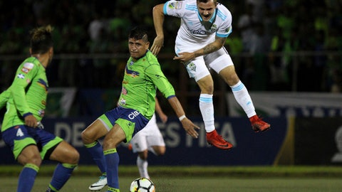 Jordan Morris, of Seattle Sounders, right, and Roberto Dominguez, of El Salvador's Santa Tecla, center, fight for the ball during a CONCACAF Champions League match in San Salvador, El Salvador, Thursday, Feb. 22, 2018. (AP Photo/Salvador Melendez)