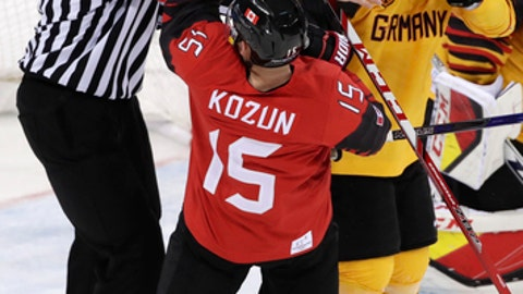 A referee breaks up a fight between Brandon Kozun (15), of Canada, and Yannic Seidenberg (36), of Germany, during the second period of the semifinal round of the men's hockey game at the 2018 Winter Olympics in Gangneung, South Korea, Friday, Feb. 23, 2018. (AP Photo/Frank Franklin II)