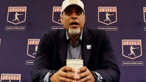 FIEL - In this Feb. 19, 2017, file photo, Tony Clark, executive director of the Major League Players Association, answers questions at a news conference in Phoenix. A proposal collapsed that would have put a runner on second base to start the 10th inning of spring training games, a person familiar with the negotiations told The Associated Press. The person spoke on condition of anonymity Friday because no statements were authorized. Management thinks the union backed off because players were upset Commissioner Rob Manfred described new pace-of-game rules that apply to the regular season as an agreement, the person said. (AP Photo/Morry Gash, File)