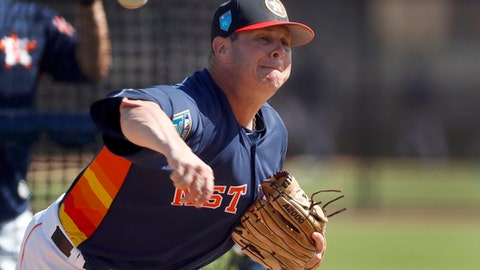 """FILE - In this Feb. 19, 2018, file photo, Houston Astros pitcher Brad Peacock throws live batting practice during spring training baseball practice in West Palm Beach, Fla. Last spring Brad Peacock entered Astros camp worried that he wouldn't make the team. After the best season of his career, the right-hander's spot with the Astros is secure this season, but he's maintained the same mindset he had when his career was on the line. """"I still want to keep that edge on me,"""" he said.(AP Photo/Jeff Roberson)"""