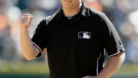 FILE - In this Sept. 21, 2015, file photo, umpire Stu Scheurwater signals during the eighth inning of the first game of a baseball doubleheader between the Detroit Tigers and the Chicago White Sox, Monday, Sept. 21, 2015, in Detroit. Scheurwater has been hired by Major League Baseball to fill the opening on its umpire staff created by Dale Scott's retirement. The 34-year-old Scheurwater had been a minor league umpire since 2007, worked big league spring training for the first time in 2013 and has appeared in 268 regular-season big league games as a call-up. Scheurwater is from Regina, Saskatchewan, and becomes the first Canadian umpire on the full-time staff since Jim McKean from 1974-2001. (AP Photo/Carlos Osorio, File)