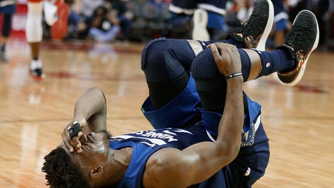 HOUSTON, TX - FEBRUARY 23:  Jimmy Butler #23 of the Minnesota Timberwolves grabs his knee after injuring himself in the third quarter against the Houston Rockets at Toyota Center on February 23, 2018 in Houston, Texas. (Photo by Bob Levey/Getty Images)