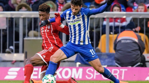 Bayern's Kingsley Coman, left, and Hertha's Mathew Leckie challenge for the ball during the German Bundesliga soccer match between FC Bayern Munich and Hertha BSC Berlin in Munich, southern Germany, Saturday, Feb. 24, 2018. (Matthias Balk/dpa via AP)