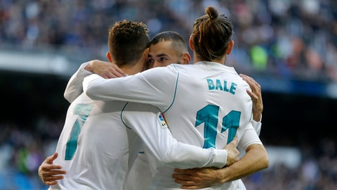 Real Madrid's Cristiano Ronaldo, left, Karim Benzema, center, and Gareth Bale celebrate a goal against Alaves during the Spanish La Liga soccer match between Real Madrid and Alaves at the Santiago Bernabeu stadium in Madrid, Saturday, Feb. 24, 2018. Ronaldo scored twice and Benzema and Bale once each in Real Madrid's 4-0 victory. (AP Photo/Francisco Seco)