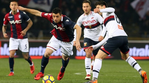 Bologna's Blerim Dzemaili, left, is challenged by Genoa's Andrea Bertolacci during the Serie A soccer match between Bologna and Genoa at the Renato Dall'Ara Stadium in Bologna, Italy, Saturday, Feb. 24, 2018. (Giorgio Benvenuti/ANSA via AP)