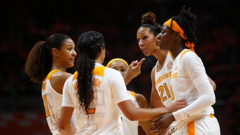 FILE -- In this Jan. 21, 2018, file photo, Tennessee guard Jaime Nared, far left, talks with Mercedes Russell (21) during the second half of an NCAA college basketball game against Mississippi State in Knoxville, Tenn. Russell and Nared were highly touted recruits who came all the way from the state of Oregon to play for the Lady Vols. The two seniors have been counted on this season to provide leadership for a team that relies heavily on freshmen while trying to make Tennessee a national contender again. (AP Photo/Crystal LoGiudice, File)