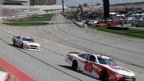 Christopher Bell (20) leads Cole Custer (00) during the NSCAR Xfinity series auto race at Atlanta Motor Speedway in Hampton, Ga., on Saturday, Feb. 24, 2018. (AP Photo/John Bazemore)