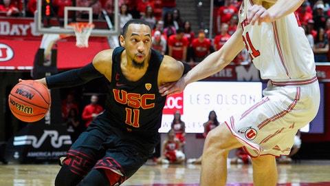 USC guard Jordan McLaughlin (11) attempts to drive past Utah forward Tyler Rawson (21) during the first half of an NCAA basketball game on Saturday, Feb. 24, 2018, in Salt Lake City. (AP Photo/Alex Goodlett)