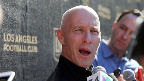 Head coach Bob Bradley talks with reporters during the introduction of players and coaches at the first training camp of the Los Angeles Football Club MLS soccer team on the campus of UCLA in Los Angeles, Monday, Jan. 22, 2018. (AP Photo/Reed Saxon)
