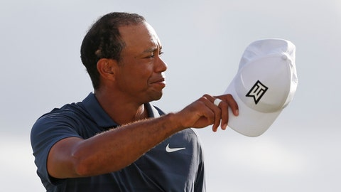 Tiger Woods tips his hat to the crowd after finishing his third round of the Honda Classic golf tournament, Saturday, Feb. 24, 2018 in Palm Beach Gardens, Fla. (AP Photo/Wilfredo Lee)