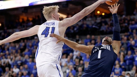 Creighton's Jacob Epperson (41) blocks a shot by Villanova's Jalen Brunson (1) during the second half of an NCAA college basketball game in Omaha, Neb., Saturday, Feb. 24, 2018. (AP Photo/Nati Harnik)