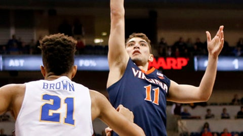 Virginia's Ty Jerome (11) shoots over Pittsburgh's Terrell Brown (21) during the first half of an NCAA college basketball game, Saturday, Feb. 24, 2018, in Pittsburgh. (AP Photo/Keith Srakocic)