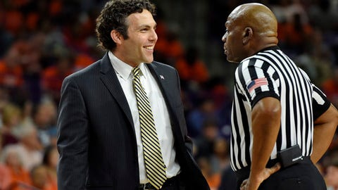 Georgia Tech head coach Josh Pastner, left, speaks with an official during the first half of an NCAA college basketball game against Clemson, Saturday, Feb. 24, 2018, in Clemson, S.C. (AP Photo/Richard Shiro)