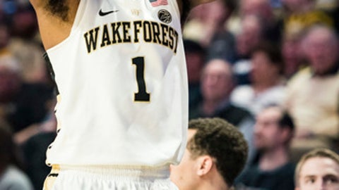 Wake Forest guard Keyshawn Woods reacts to letting a pass go out of bounds with only seconds remaining in the second half of an NCAA college basketball game Saturday, Feb. 24, 2018, in Winston-Salem, N.C. Notre Dame defeated Wake Forest, 76-71. (Allison Lee Isley/The Winston-Salem Journal via AP)