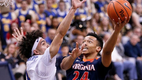 Virginia's Marco Anthony (24) shoots as Pittsburgh's Parker Stewart (1) defends during the second half of an NCAA college basketball game, Saturday, Feb. 24, 2018, in Pittsburgh. Virginia won 66-37.(AP Photo/Keith Srakocic)