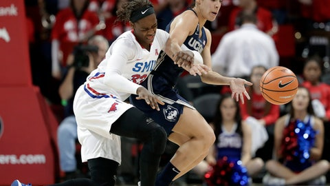 SMU's Johnasia Cash (33) loses control of the ball to Connecticut's Kia Nurse during the first half of an NCAA college basketball game Saturday, Feb. 24, 2018, in Dallas. (AP Photo/Tony Gutierrez)