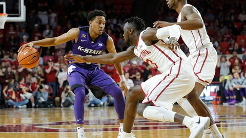 Kansas State's Kamau Stokes, left, is guarded by Oklahoma's Khadeem Lattin, center, and Rashard Odomes, right, during the first half of an NCAA college basketball game in Norman, Okla., Saturday, Feb. 24, 2018. (AP Photo/Garett Fisbeck)