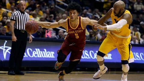 Iowa State guard Lindell Wigginton (5) drives while being defended by West Virginia guard Jevon Carter (2) during the first half of an NCAA college basketball game Saturday, Feb. 24, 2018, in Morgantown, W.Va. (AP Photo/Raymond Thompson)