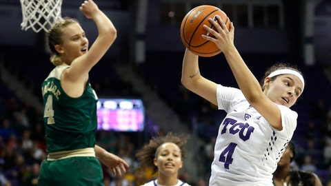 TCU guard Amber Ramirez (4) rebounds as Baylor guard Kristy Wallace (4) looks on during the first half of an NCAA college basketball game, Saturday, Feb. 24, 2018 in Fort Worth, Texas. (AP Photo/Ron Jenkins)