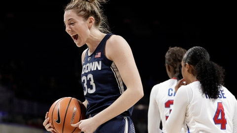 Connecticut guard/forward Katie Lou Samuelson (33) celebrates a basket as SMU's Mikayla Reese (4) walks away during the second half of an NCAA college basketball game Saturday, Feb. 24, 2018, in Dallas. (AP Photo/Tony Gutierrez)