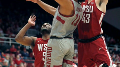 Stanford guard Dorian Pickens (11) drives to the basket against between Washington State forward Drick Bernstine (43) and guard Milan Acquaah (5) during the first half of an NCAA college basketball game Saturday, Feb. 24, 2018, in Stanford, Calif. (AP Photo/Tony Avelar)