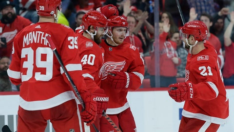 Detroit Red Wings center Henrik Zetterberg (40), of Sweden, celebrates his goal against the Carolina Hurricanes with Gustav Nyquist (14), of Sweden; Anthony Mantha (39); and Tomas Tatar (21), of Slovakia, during the second period of an NHL hockey game Saturday, Feb. 24, 2018, in Detroit. (AP Photo/Duane Burleson)