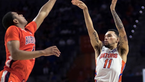 Florida guard Chris Chiozza (11) shoots over Auburn forward Chuma Okeke (4) during the first half of an NCAA college basketball game in Gainesville, Fla., Saturday, Feb. 24, 2018. (AP Photo/Ron Irby)
