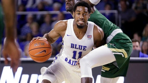 Middle Tennessee guard Edward Simpson (11) drives past UAB forward Makhtar Gueye during the second half of an NCAA college basketball game Saturday, Feb. 24, 2018, in Murfreesboro, Tenn. (AP Photo/Mark Humphrey)