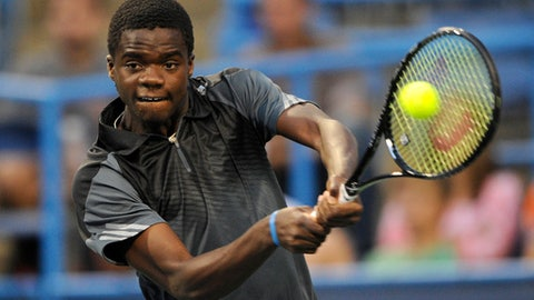 Francis Tiafoe returns the ball against Evgeny Donskoy, of Russia, during a match in the Citi Open tennis tournament, Monday, July 28, 2014, in Washington. (AP Photo/Nick Wass)
