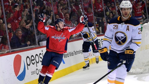 Washington Capitals left wing Andre Burakovsky, left, of Austria, left, celebrates his goal against the Buffalo Sabres during the second period of an NHL hockey game at Capital One Arena in Washington, Saturday, Feb. 24, 2018. Buffalo Sabres right wing Jason Pominville (29) skates at right. The Capitals won 5-1. (AP Photo/Susan Walsh)