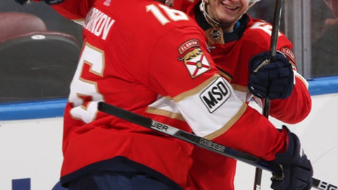 Florida Panthers right wing Evgeni Dadonov (63) celebrates his second goal with center Aleksander Barkov (16) during the third period of an NHL hockey game against the Pittsburgh Penguins, Saturday, Feb. 24, 2018, in Sunrise, Fla. (AP Photo/Joel Auerbach)