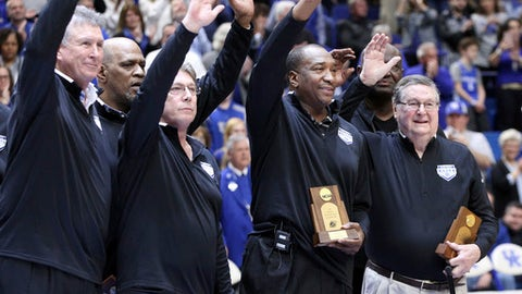Former Kentucky coach, Joe B. Hall, right, and members of the 1978 championship team wave to the crowd before the second half of the team's NCAA college basketball game against Missouri on Saturday, Feb. 24, 2018, in Lexington, Ky. (AP Photo/James Crisp)