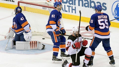 New Jersey Devils right wing Kyle Palmieri (21) celebrates his second goal against New York Islanders goaltender Jaroslav Halak (41) as Islanders center John Tavares (91) and defenseman Johnny Boychuk (55) react during the third period of an NHL hockey game Saturday, Feb. 24, 2018, in Newark, N.J. The Devils defeated the Islanders 2-1. (AP Photo/Bill Kostroun)