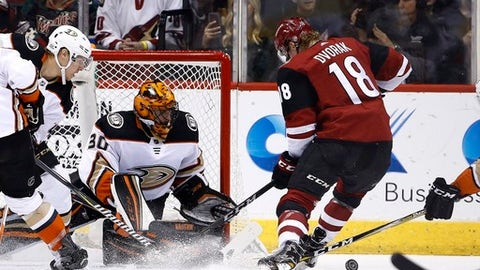 Anaheim Ducks goaltender Ryan Miller (30) makes save on a shot by Arizona Coyotes center Christian Dvorak (18) as Ducks defenseman Hampus Lindholm, left, watches during the first period of an NHL hockey game Saturday, Feb. 24, 2018, in Glendale, Ariz. The Coyotes defeated the Ducks 2-0. (AP Photo/Ross D. Franklin)