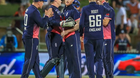 England's Ben Stokes, third from left, celebrates taking the wicket of New Zealand's Colin de Grandhomme during their One Day International cricket match in Hamilton, New Zealand, Sunday, Feb. 25, 2018. (AP Photo/John Cowpland)
