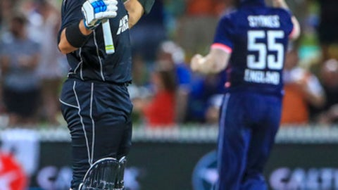 New Zealand's Ross Taylor, left, celebrates his 100 runs during a One Day International cricket match against England in Hamilton, New Zealand, Sunday, Feb. 25, 2018. (AP Photo/John Cowpland)