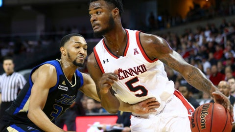 Tulsa's  Corey Henderson Jr., left, defends against Cincinnati's Trevor Moore, right, during the first half of an NCAA college basketball game, Sunday, Feb. 25, 2018, in Highland Heights, Ky. (AP Photo/Aaron Doster)
