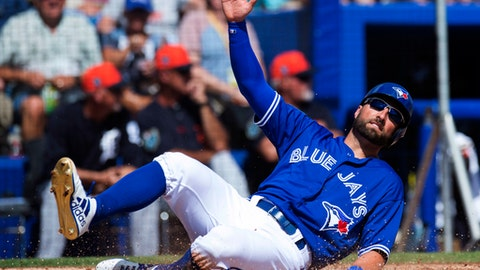 Toronto Blue Jays Kevin Pillar slides in to score on the Detroit Tigers during second inning exhibition baseball action in Dunedin, Fla., Sunday, Feb. 25, 2018. (Frank Gunn/The Canadian Press via AP)