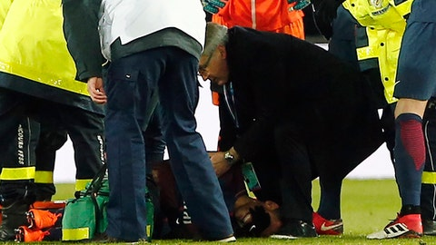 PSG's Neymar lays on the pitch after being injured during the French League One soccer match between Paris Saint-Germain and Marseille at the Parc des Princes Stadium, in Paris, France, Sunday, Feb. 25, 2018. (AP Photo/Thibault Camus)